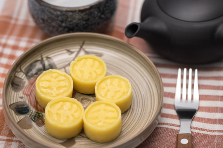 yellow tea pot: Delicious and sweet Chinese yellow bean cake for dessert background Stock Photo