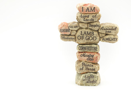 my name is: Stone crafted in cross shape with names of God for religion background Stock Photo