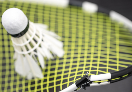 hot temper: Broken badminton racket with shuttlecock for game background