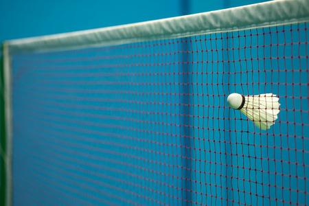 struck: Shuttlecock struck in the net in badminton court