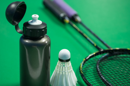 thirsty bird: Image of badminton rackets and shuttlecock with water bottle Stock Photo