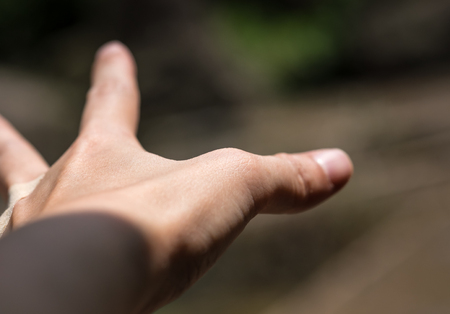 reaching out: Adults hands with reaching out gesture for sign and symbol background Stock Photo