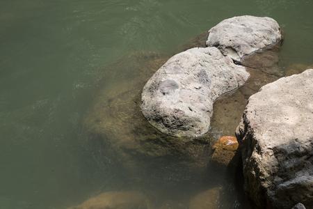 kwaśne deszcze: Eroded hard rock in the water or lake for nature background Zdjęcie Seryjne