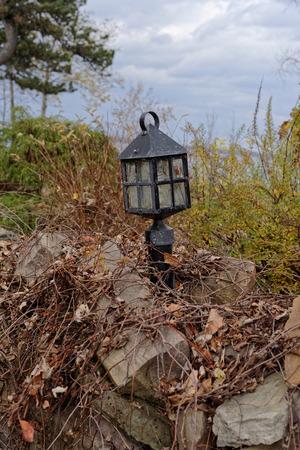 Wrought iron lantern on rock wall