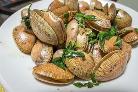 Clam fried peeper sauce with basil Stock Photo