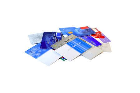 Credit cards disorderly are scattered on a white background.