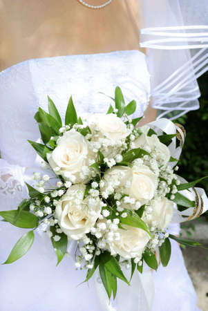 Beautiful white wedding bouquet in hands of the bride. Stock Photo - 7637256