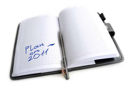 take down notice: Record in a notebook, the plan for new year 2011 Stock Photo