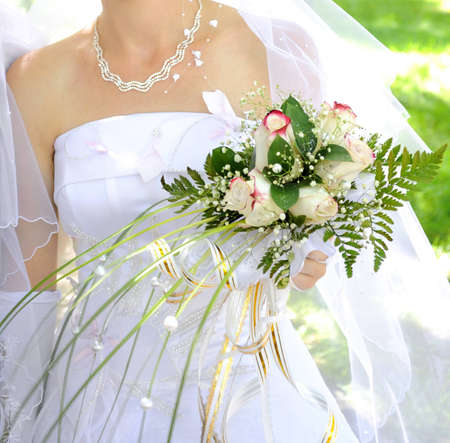 Beautiful white wedding bouquet in hands of the bride. Stock Photo - 8833498