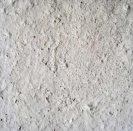 pitted: primo piano di tessitura muro di cemento