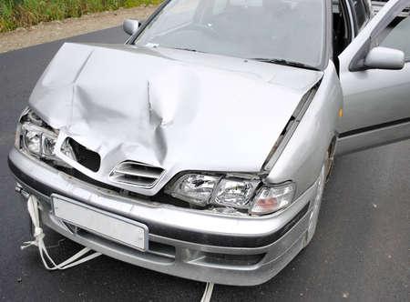 dent: The modern car broken after road failure Stock Photo