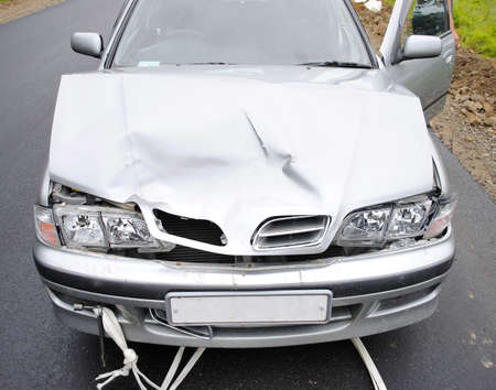 total loss: The modern car broken after road failure Stock Photo