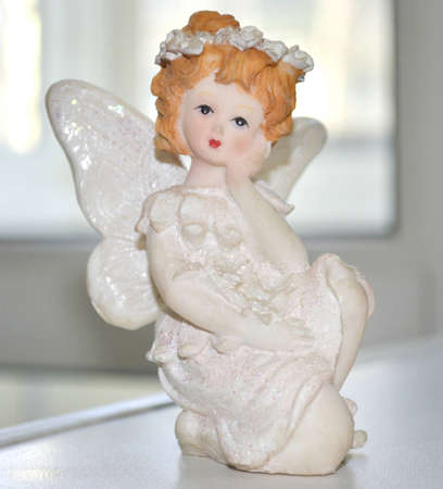 Porcelain figure of the little girl photo