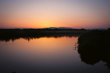 rise to the top: Sunset on the river of the Far East