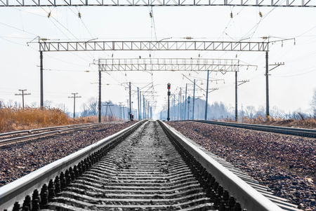 railway transportations: Railroad tracks stretching into the distance beyond the horizon
