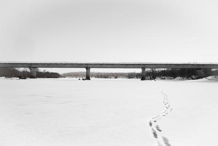 Concrete bridge over the frozen river Banco de Imagens