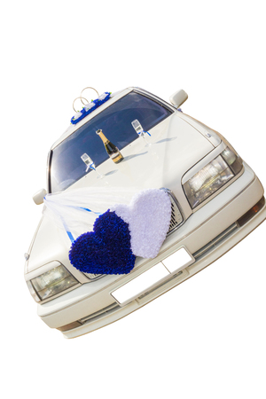 The white wedding car decorated with flowers on a white background.
