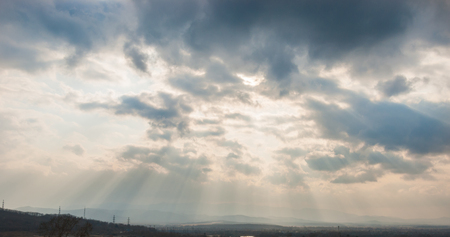 Clouds and sun ray on blue sky background