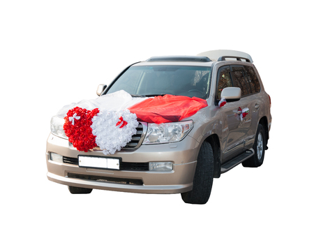 The wedding car decorated with flowers on a white background.