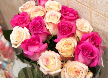 Pink faded roses bouquet with leaves
