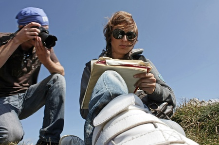 photojournalist: Photographing and documenting. Outdoor job.