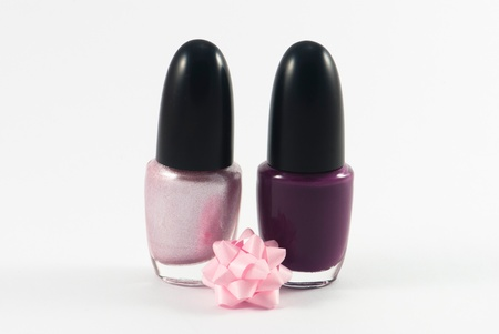 Pink and violet nail polish. Manicure concept. Isolated on white.