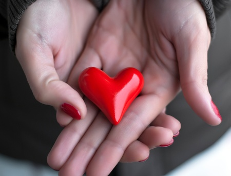 goodness: Red heart in woman hands Stock Photo