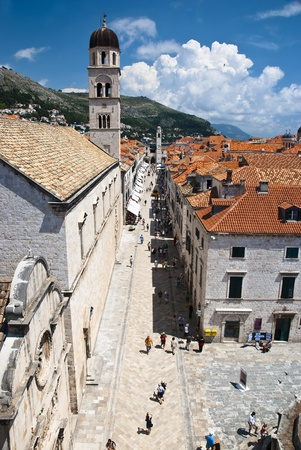 The main street of Dubrovnik the Placa Stradum on a busy summers day with many people walking down the avenue. Photo taken at 09th of July 2009