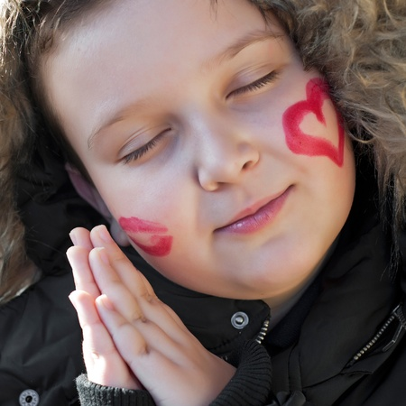 cheeks: Happy child sleep with valentines heart on cheek
