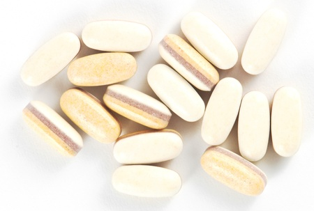 Probiotic pills on white background Banque d'images