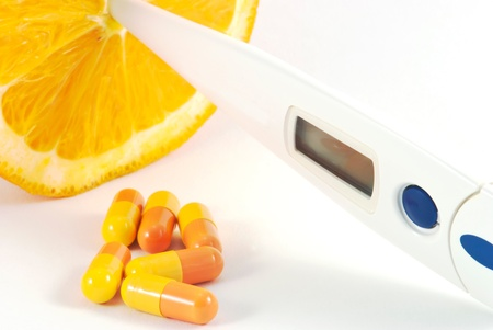 Orange fruit with vitamins and termometer Stock Photo