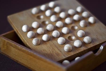 Detail of wooden brain teaser photo