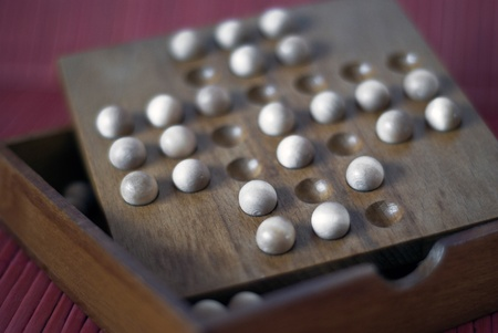 solving problem: Solving problem with small wooden balls Stock Photo