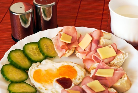 Fried egg with canapés and milk photo