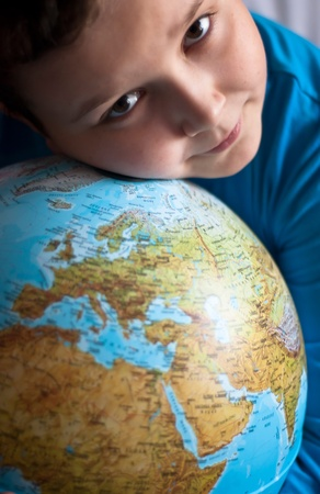 Little boy and his favourite globe Stock Photo - 12279941