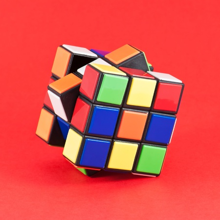 In a classic Rubik's Cube, each of the six faces is covered by 9 stickers, among six solid colours (traditionally white, red, blue, orange, green, and yellow)
