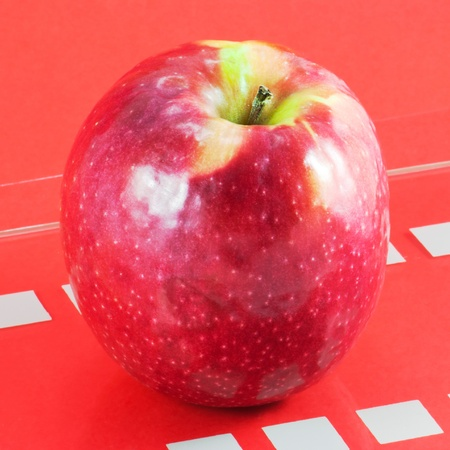 Shot of red apple on table Stock Photo - 12324745