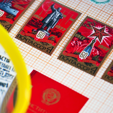 Reminiscing about stamp collections above a stamp album