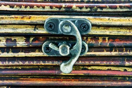 hasp: Wooden background with little iron hasp