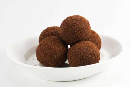 Chocolate balls on the white plate photo