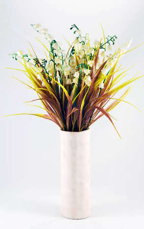 Bunch of lily of the valley in a vase photo