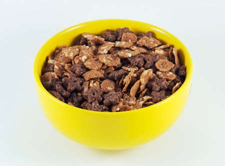 Sugary cereal in a yellow bowl photo