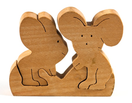Wooden folding toy on white background photo