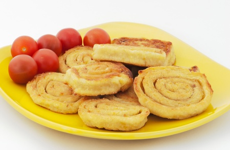 Potato savories on yellow plate with tomatoes Stock Photo - 13321286