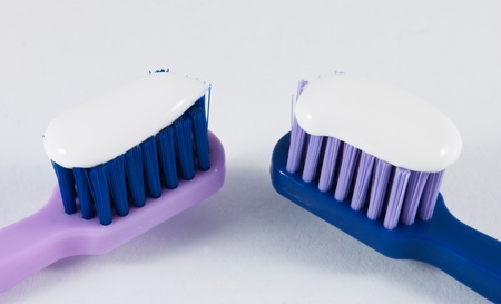 Image of two toothbrushes and some paste photo