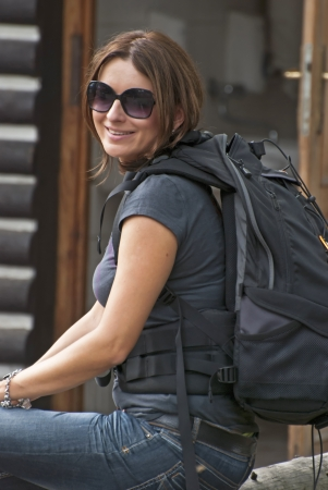 packsack: Female tourist with big backpack Stock Photo
