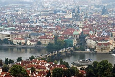 Famous historic Charles bridge crosses the Vltava river in Prague, Czech Republic. Stock Photo