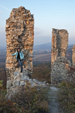 Young woman and ruins of the old castle Stock Photo