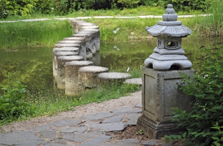 Decorative Stone Pagoda In Green Garden With Stone Walkway Over ...