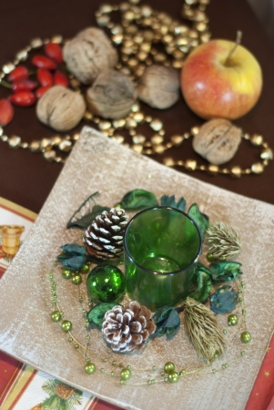 Christmas table decoration with walnuts and apple photo